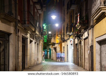 night view of old  street of european city.  Girona, Catalonia