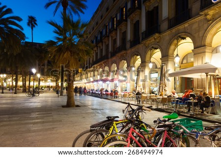 night view of Placa Reial with restaurants in winter. Barcelona, Spain - stock photo
