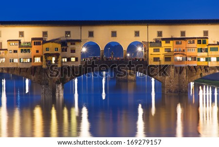 Night view of Ponte Vecchio over Arno River in Florence, Italy