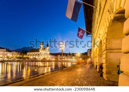 Night view of river Reuss and Jesuitenkirche in Lucerne, Switzerland - stock photo