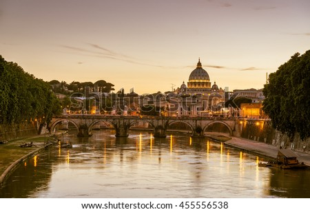 Night view of Rome. Ponte Sant`Angelo (Bridge of Holy Angel) and Basilica San Pietro (Saint Peter's cathedral). Italy.
