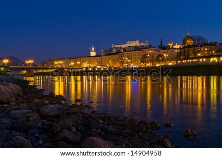 Night view of Salzach river in the historical center of Salzburg