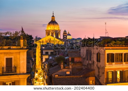 Night view of San Carlo al Corso, Chiesa di San Rocco all'Augusteo and St. Peter's cathedral in Vatican City Rome Italy. - stock photo