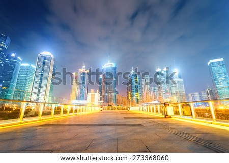 night view of shanghai financial center skyline with pedestrian sightseeing bridge - stock photo