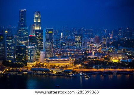 Night view of Singapore city center. Skyline of central districts. Modern architecture in Asia. Financial buildings, skyscrapers at night. Waterfront and the sea. - stock photo