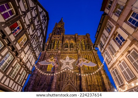 Night view of Strasbourg's impressive Cathedral during Christmas Season - stock photo