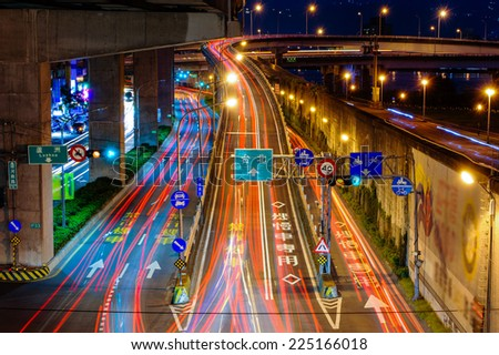 night view of Taipei city with traffic trails - stock photo