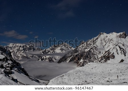 Night view of the Andes and the valley that is the entrance to Plaza de Mulas base camp. Aconcagua Provincial Park, Mendoza, Argentina, South America. - stock photo