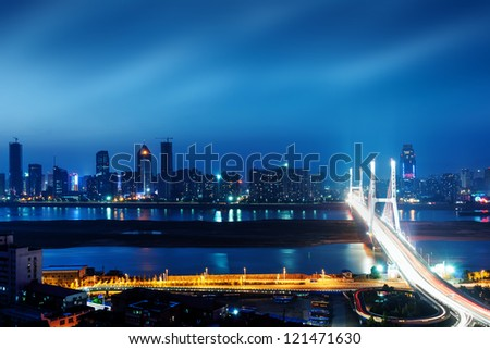 Night view of the bridge and city in shanghai china.