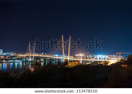 night view of the bridge in the Russian Vladivostok over the Golden Horn bay - stock photo