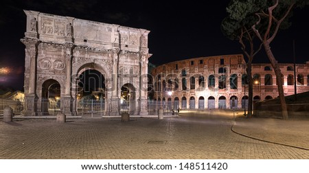 night view of The Colosseum and The Arch of Constantine in Rome. Italy. - stock photo