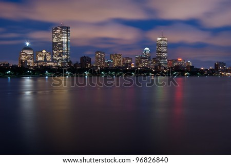 Night view of the full Boston Skyline with brightly illuminated buildings - stock photo
