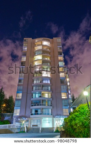 Night view of the glow high-rise building - stock photo