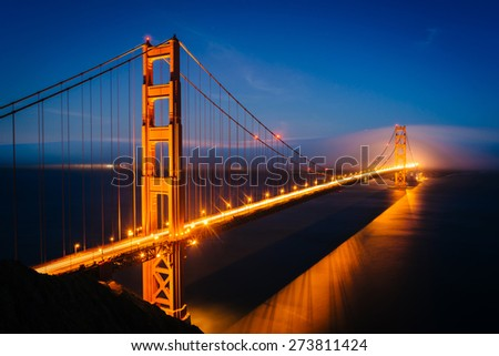 Night view of the Golden Gate Bridge and fog from Battery Spencer,  Golden Gate National Recreation Area, in San Francisco, California.