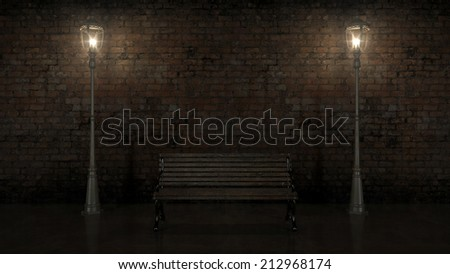 Night view of the illuminated brick wall with old street  - stock photo