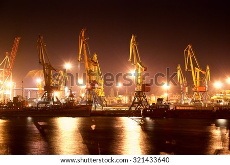 night view of the industrial port with cranes - stock photo