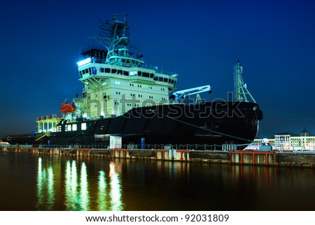Night view of the moored  ship in the spotlight - stock photo