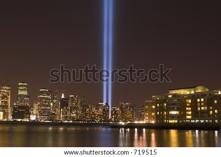 Night view of the New York with 9/11 memorial lights - stock photo