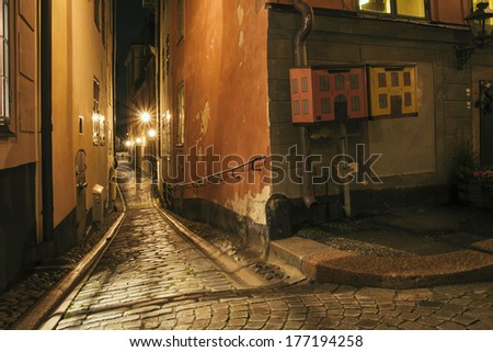 Night view of the old narrow street. Stockholm, Sweden. Effect retro film