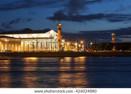 Night view of the rostral columns, Exchange Building, Neva from the Palace Embankment. Petersburg, Russia