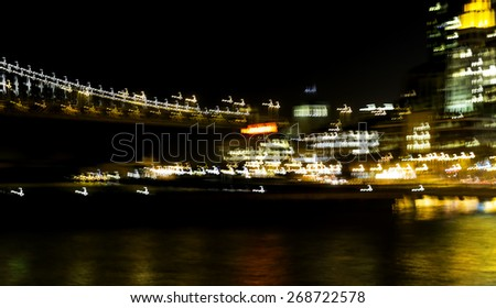 Night view of the San Francisco waterfront skyline and Bay Bridge with intentional motion blur - stock photo