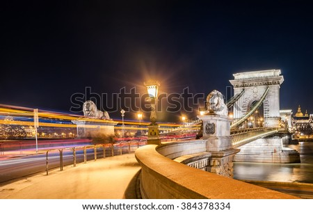 Night view of the Szechenyi Chain Bridge is a suspension bridge that spans the River Danube between Buda and Pest, the western and eastern sides of Budapest, the capital of Hungary. - stock photo