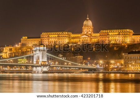 Night view of the Szechenyi Chain Bridge over Danube River and Royal Palace in Buda Castle in Budapest, Hungary - stock photo