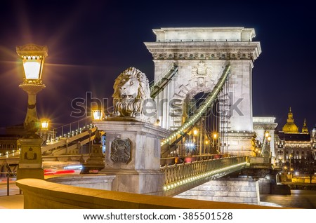 Night view of the Szechenyi Chain Bridge over Danube River and stone lion. Nightlife of Budapest, Hungary. - stock photo
