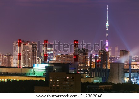 Night view of the urban development of Moscow. Focus on the middle pipe plan - stock photo