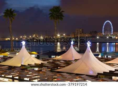Night View of the Waterfront of Malaga City, Spain - stock photo