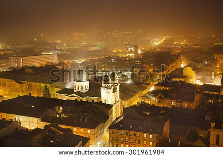 Night view of western european city Lviv, architecture background in golden colors - stock photo