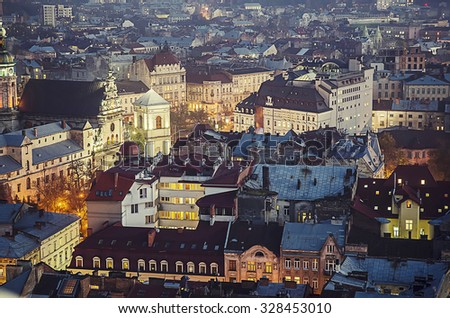 Night view of western european city Lviv, architecture background in vintage hipster style - stock photo