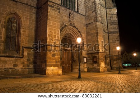 night view on main door of Gothic Cathedral of St. Bartholomew on Pilsen city square in Czech republic - stock photo