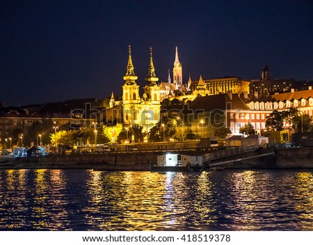 night view on Matthias church and illuminated Budapest from Danube