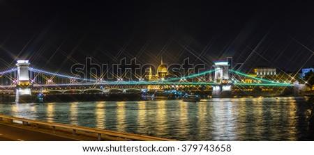 Night view on Szechenyi Chain Bridge over Danube river in Budapest, Hungary. Cross Filter Effect - stock photo