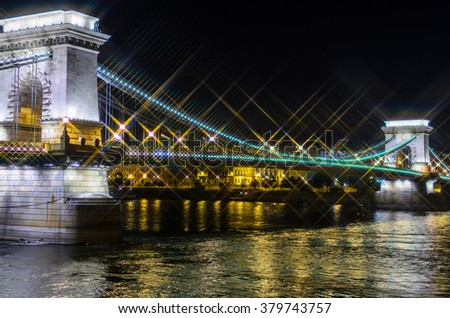 Night view on Szechenyi Chain Bridge over Danube river in Budapest, Hungary. Cross Filter Effect