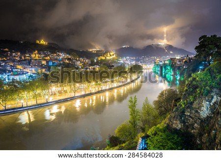 Night view on Tbilisi with Kura River, Georgia - stock photo