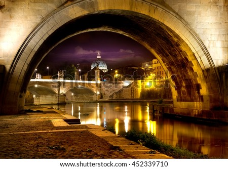 Night view on the Sant Angelo Bridge and Basilica of St. Peter in Rome, Italy - stock photo