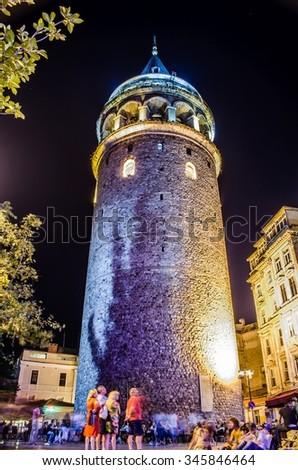 Night view over illuminated galata tower in beyoglu, istanbul. - stock photo