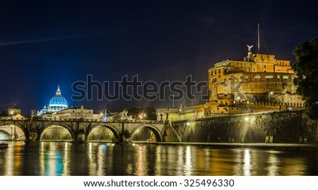 Night view over tiber river, saint peters basiica, castel sant angelo and ponte sant angelo in rome - stock photo