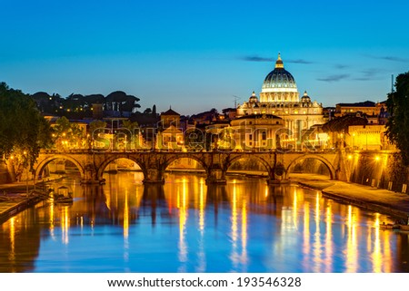 Night view Ponte Sant'Angelo (Bridge of Holy Angel) and San Pietro (Saint Peter's basilica) in Rome, Italy