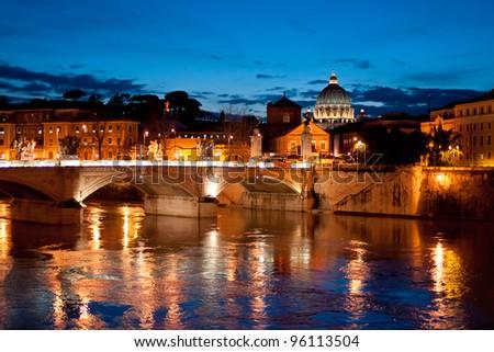Night view to San Pietro basilica (Vatican) over Tiber river. - stock photo