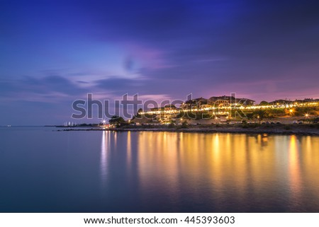 Night view to the coastal city at summer