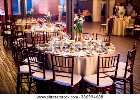 night wedding table decorated with indoor lights  - stock photo