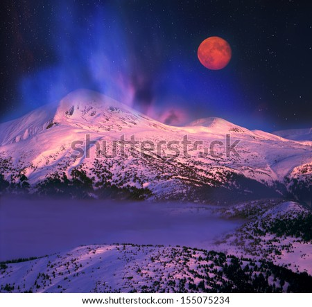 Night winter ascent on the Montenegrin ridge-captivating and dangerous, concealing the romance and fantasy, a real Klondike for the landscape photographer. Moonrise hypnotizes the audience - stock photo