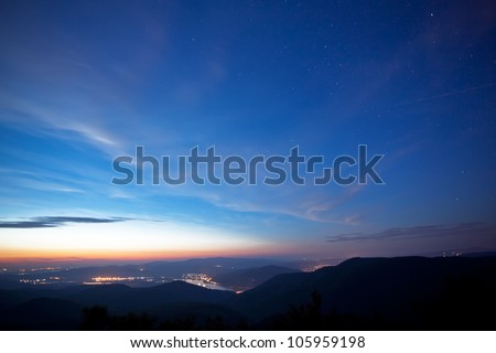 Night with stars and lights,panorama photo from Hungary,on the mountain Pilis - stock photo