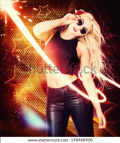 Nightclub trance girl dancing around a 1970 disco club of bright lights, stars and glitter wearing sunglasses tank top and leather jeans. Pinup starlet - stock photo