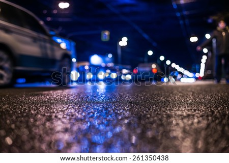 Nightlife, man catches a taxi voting on the sidelines. In blue tones - stock photo