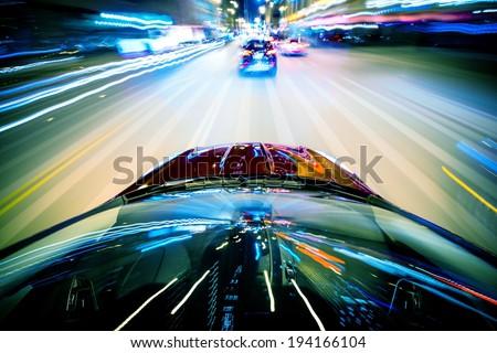 Nightly City Traffic Motion Blurs. Colorful Urban Illumination in Motion Blur. City Streets Speeding Car. - stock photo