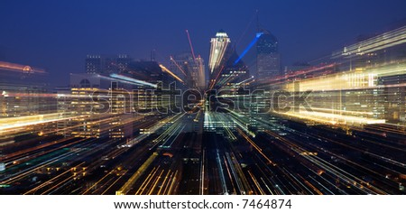 Nightly skyline with bright lights, zoomed - stock photo